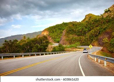 a highway to Samana Peninsula through rocky mountain. Boulevard Turistico Atlantico, 133. Dominican Republic