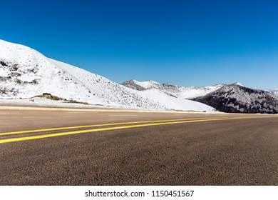 highway and snow mountain in tibet plateau