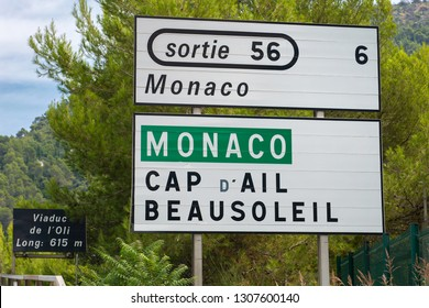Highway in southern France: 09.09.2018: Road sign with direction to Principality of Monaco (also Cap d'Ail and Beausoleil)