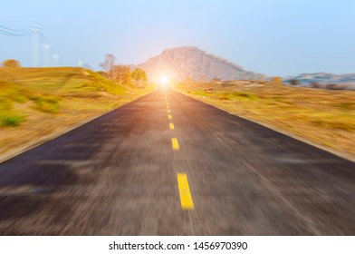 highway in steppe against a blue sky,long road stretching out into the distance