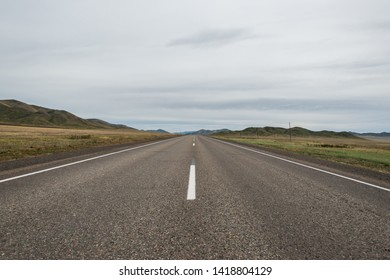 The highway in the steppe. Southern Siberia. Russ