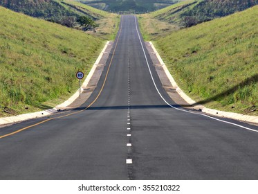 A highway stretches off into the distance.
