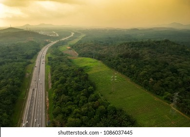 A highway that connected South and North of Peninsular Malaysia. Known as PLUS Highway. An arial view via drone on a sunset scenery.