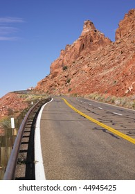 Highway through barren rocky hills. Vertical shot.