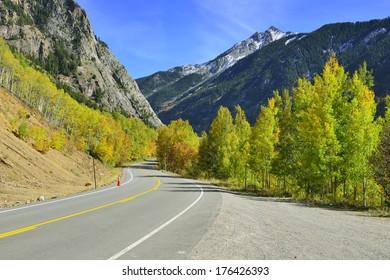 highway through the colourful mountains of Colorado during foliage season