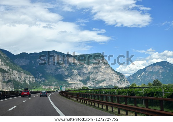 highway through mountainous trentino landscape italy with cars on holiday transit