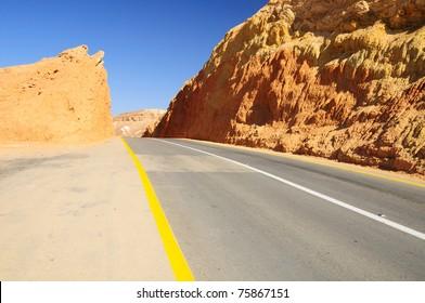 Highway through stone desert. Negev. Israel.