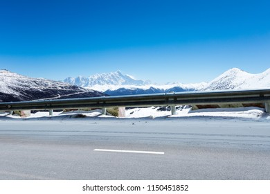 highway and tibetan famous snow mountain landscape