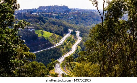 Highway in toowoomba queensland in the middle of trees from picnic point lookout