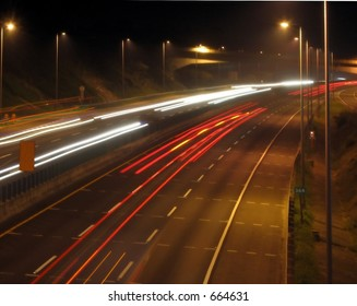 Highway Traffic at Evening Time -- on a six lane expressway