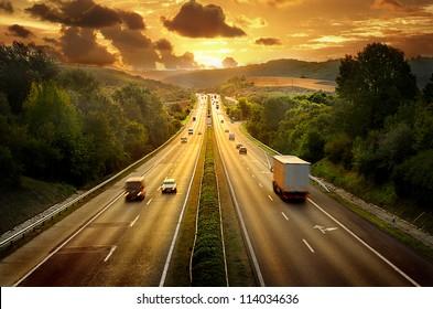 Highway traffic in sunset - Shutterstock ID 114034636