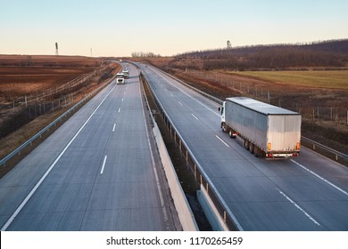 Highway with trucks passing by
