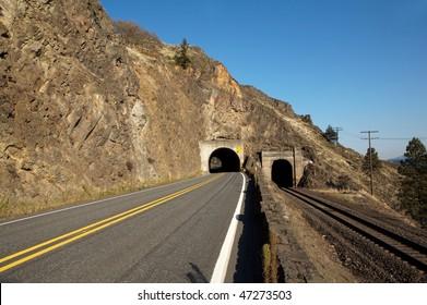 A highway tunnel cutting through a mountain