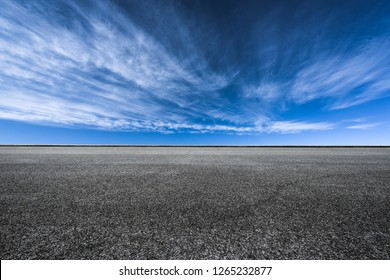 The highway under the blue sky and white clouds