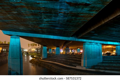 Highway Underpass Illuminated in Blue