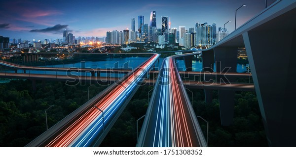 Highway with vehicle light trails leading to modern illuminated night modern cityscape. Forward to smart city concept . Mixed media .