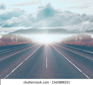 Highway and winter travel. .Road through the fog in nature landscape