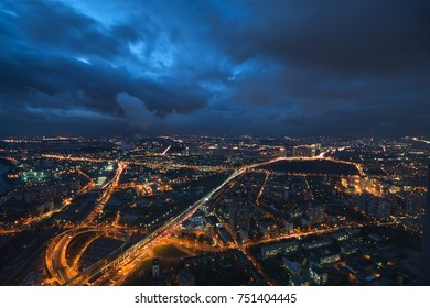 Highways, tall buildings at night and storm clouds in Moscow, Russia