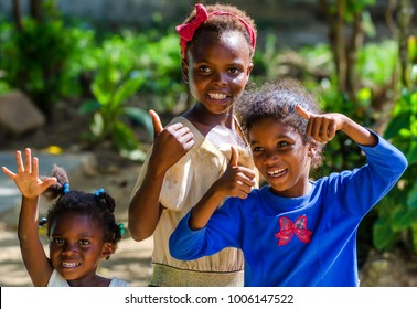 HIGUEY, DOMINICAN REPUBLIC - CIRCA NOVEMBER 2015: Three unidentified Dominican girls