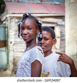 HIGUEY, DOMINICAN REPUBLIC - NOVEMBER 19, 2014: portrait of smiling haitian children in refugee camp in Dominican Republic