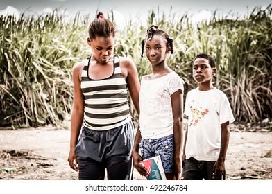 HIGUEY, DOMINICAN REPUBLIC - NOVEMBER 19, 2014: portrait of poor haitian children in refugee camp in Dominican Republic