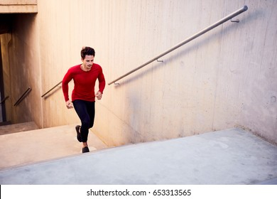 Hiit cardio workout on stairs. Young athlete doing interval exercises