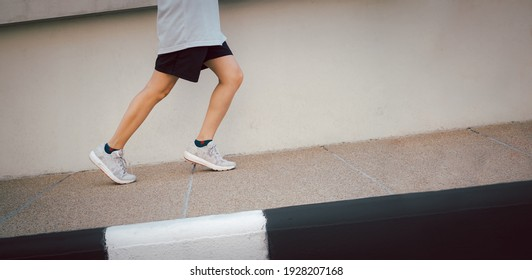 Hiit workout cardio running jogging up the Slope road way training. Slope climbing run woman going run up steps. Runner athlete doing cardio sport workout.