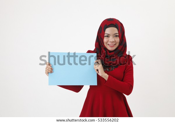 hijab with red tudung holding a paper cardboard