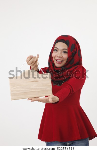 hijab with red tudung holding wooden board