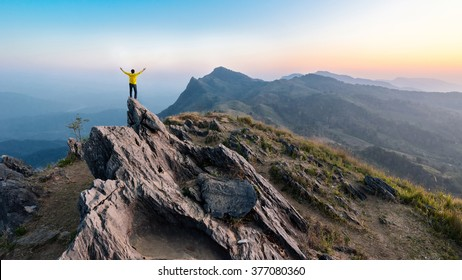 Hike on the peak of rocks mountain at sunset, active lifestyle, adventure concept.