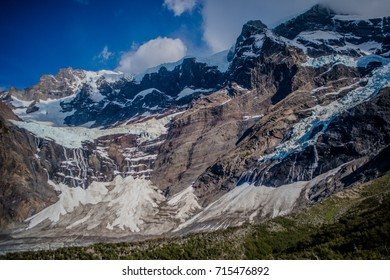 Hike in Torres del Paine, at mirador on Italiano trail looking at snow top mountain on the left with avalanche. Chile, Patagonia.