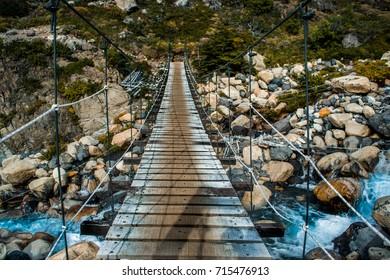 Hike in Torres del Paine, suspension bridge crossing. Chile, Patagonia.