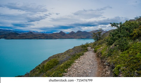 Hike in Torres del Paine, turquoise coloured-lake near Glacier Grey. Chile, Patagonia.