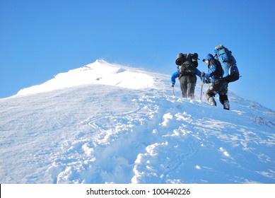Hike in a winter mountain