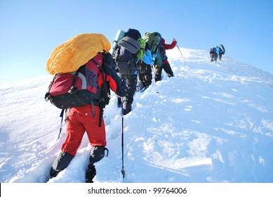 Hike in winter mountain