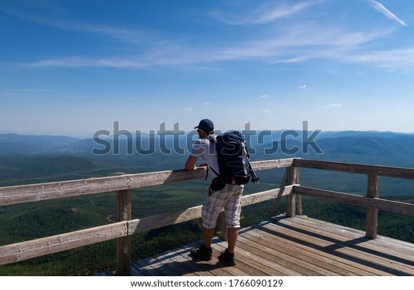 hiker-admiring-beautiful-view-top-600w-1