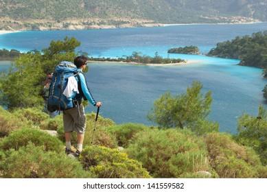hiker against the blue-sky bay