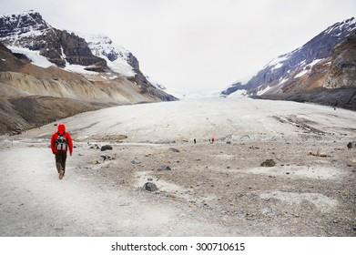 Hiker at Athabasca Glacier in Banff National Park, Canada