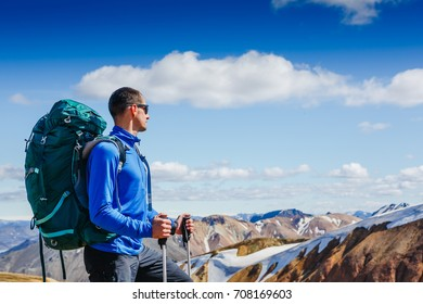 hiker with backpack enjoying the landscape of Iceland while hiking the Laugavegur trail