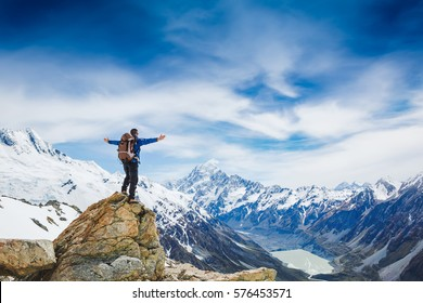 Hiker with backpack on the mountain top. Sport and active life concept