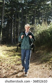 Hiker with backpack walking in forest
