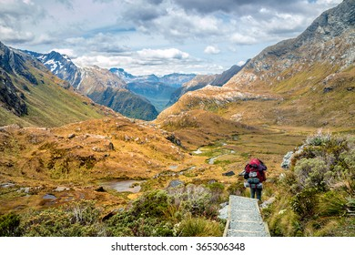 Hiker with Big Backpack Walks the Routeburn Track, New Zealand