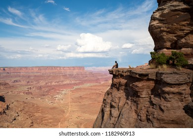 Hiker Cliff Edge Canyonlands National Park