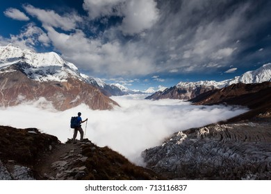 Hiker is climbing to Manaslu base camp in highlands of Himalayas on Manaslu circuit