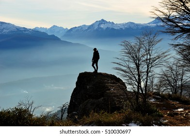 Hiker climbing to the top of the mountain in the Andes