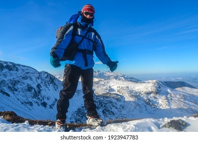 Hiker in cold winter mountains