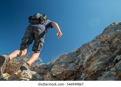 Hiker crossing rocky terrain in the Bryce Canyon National Park, USA
