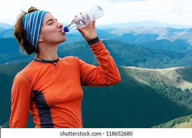 Hiker drinks