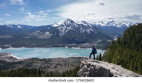 Hiker enjoying beautiful alpine vista in Canadian Rockies at Prairie View Trail, Kananaskis, Alberta, Canada