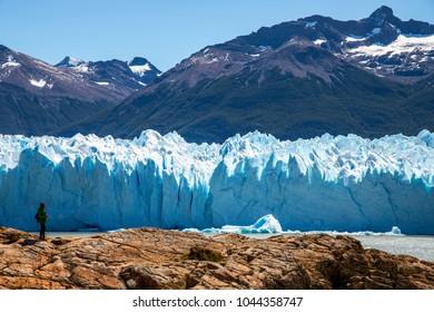 Hiker enjoying the view of the amazing Perito Moreno glacier